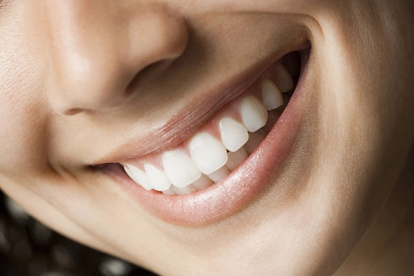 www.123nhanh.com: Bọc răng sứ cho 2 răng cửa như thế nào?